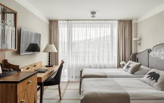 Deluxe Room with balcony overlooking the mountains