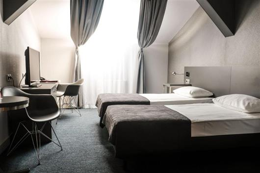 Adults max: 2  Economy Room with  beds